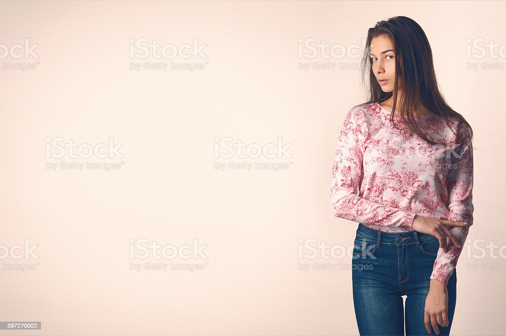 Beautiful young woman in casual clothes on a light background photo libre de droits