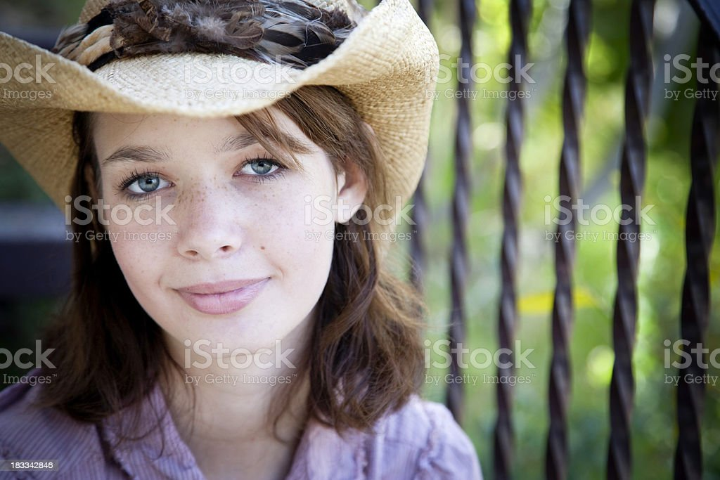 Beautiful Young Woman in Cowboy Hat Outside royalty-free stock photo