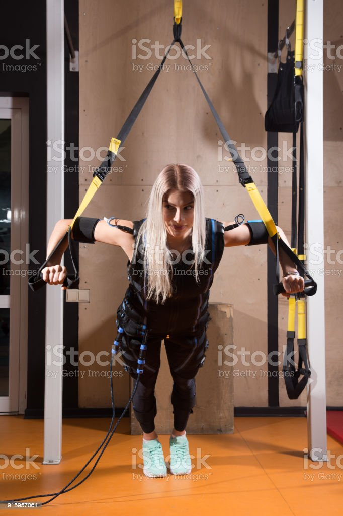 Beautiful young woman in Electrical Muscular Stimulation stock photo