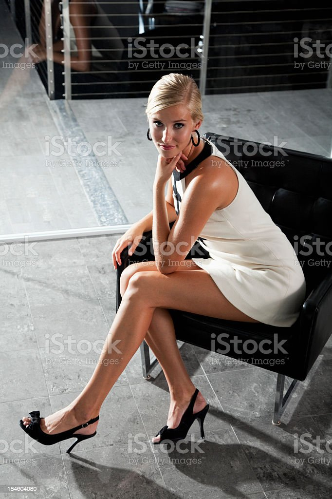 Beautiful young woman in evening wear on terrace stock photo
