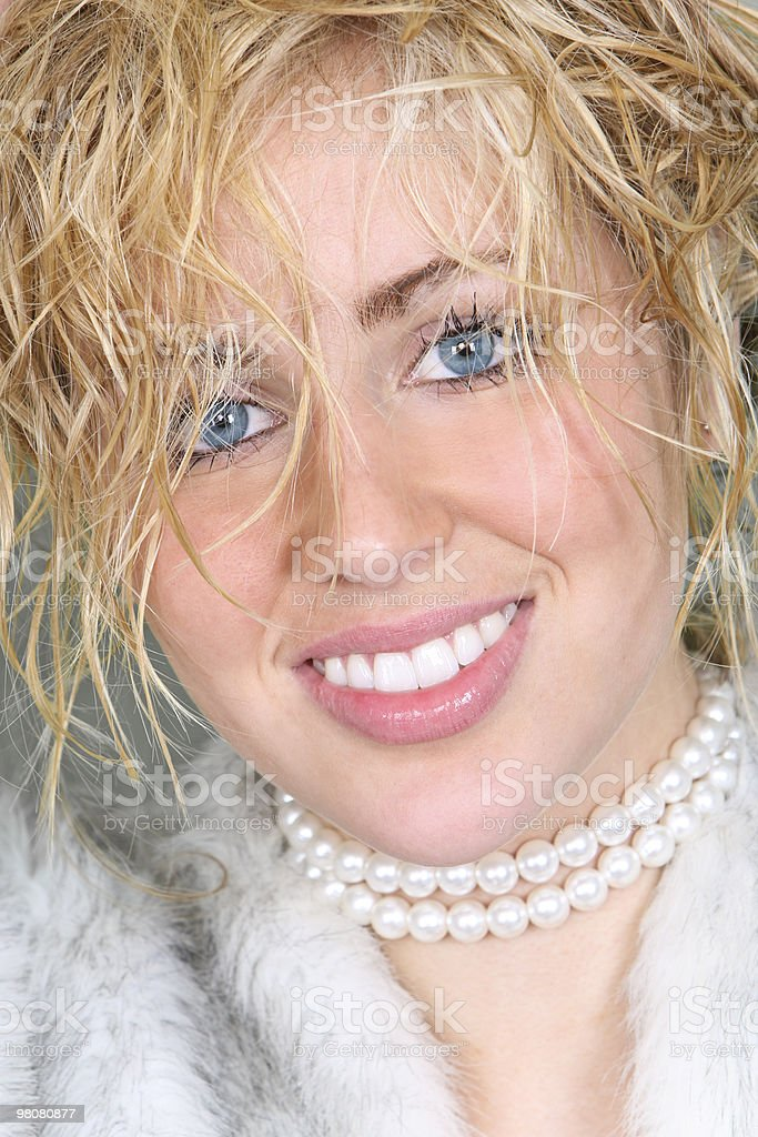 Beautiful Young Woman In Fake Fur Coat and Pearls royalty-free stock photo
