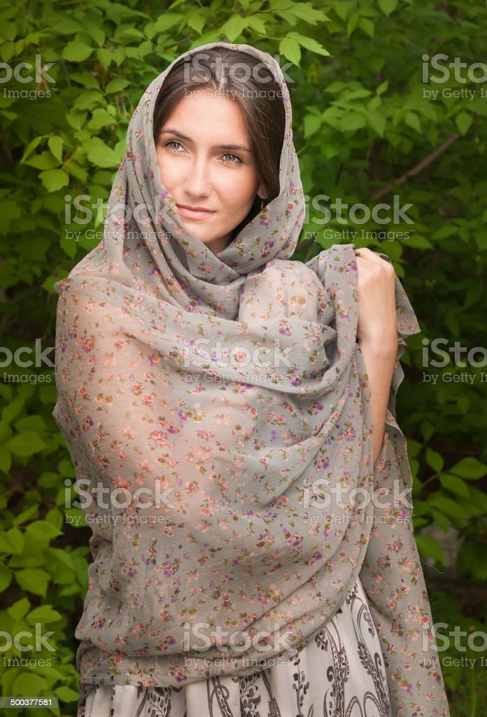 Beautiful young woman in gray cape stock photo