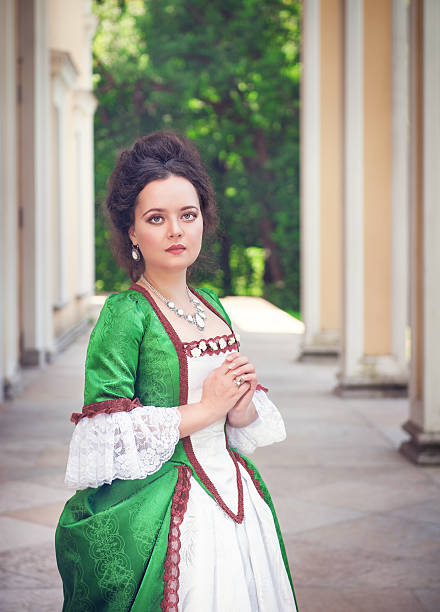 beautiful young  woman in green medieval dress - petticoat stock pictures, royalty-free photos & images