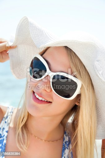 istock Beautiful young woman in hat 186835384