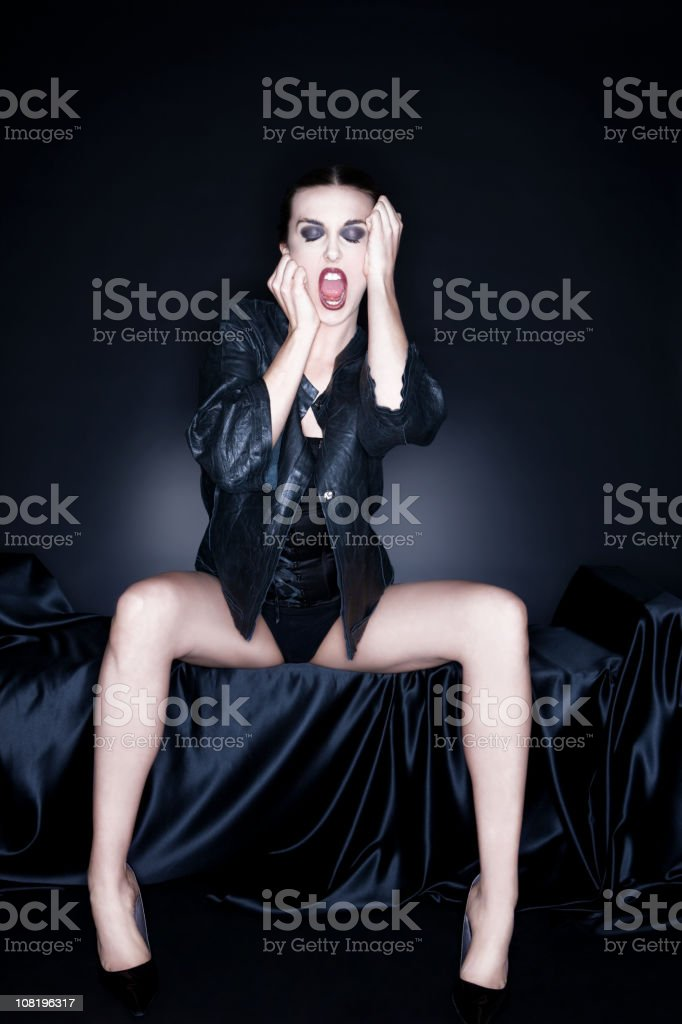 Beautiful Fashion Model Screaming with Eyes Closed, on Black royalty-free stock photo