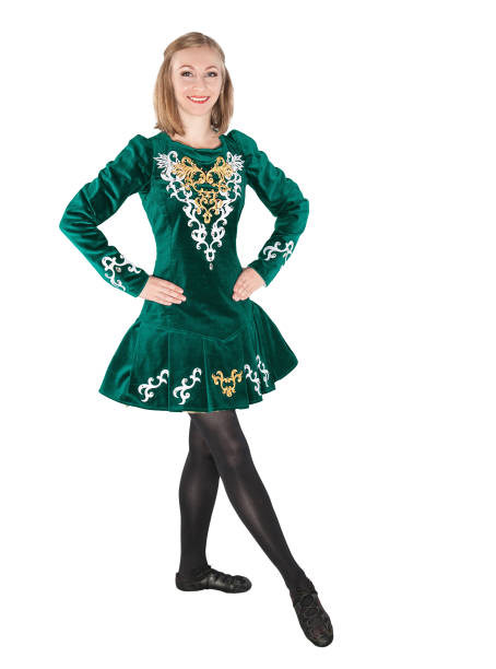8bd6af4ecc00 Beautiful young woman in Irish dance green dress isolated stock photo