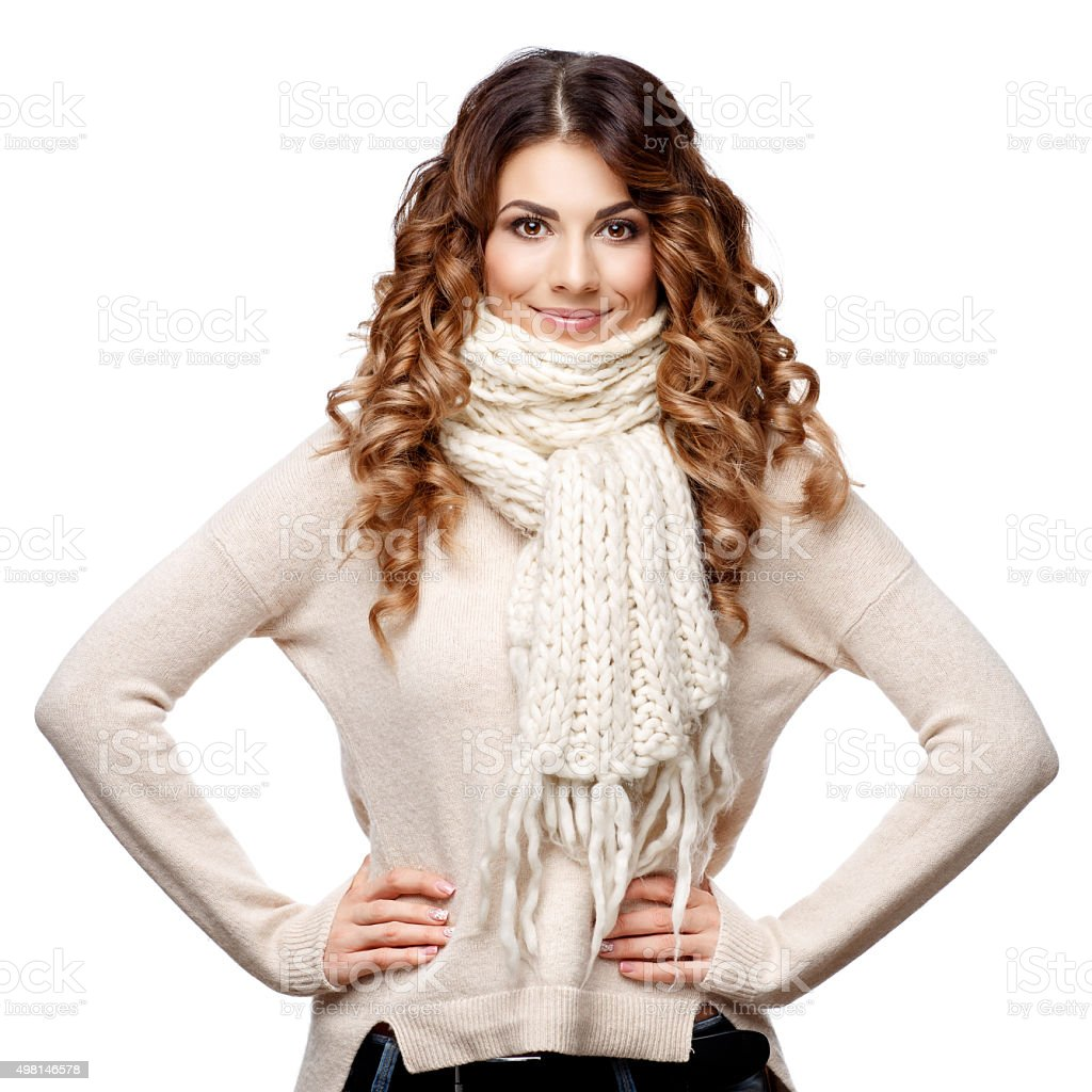 Beautiful young woman in knitted wool sweater smiling stock photo