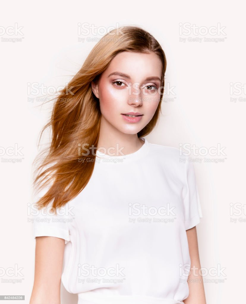 Beautiful young woman in lovely white dress stock photo