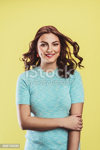 Beautiful young woman in pastel on yellow