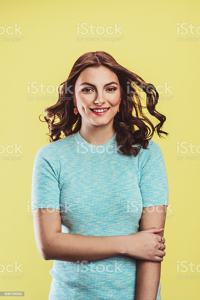 Beautiful young woman in pastel on yellow stock photo