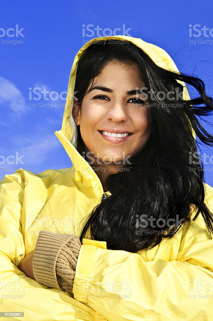 Beautiful young woman in raincoat royalty-free stock photo