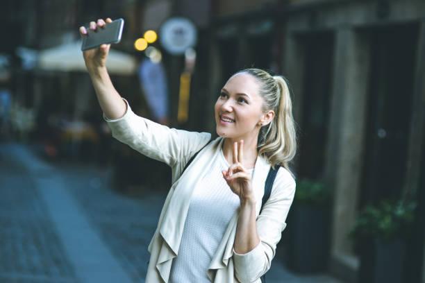 beautiful young woman in real life, she making selfie - esplanada portugal imagens e fotografias de stock