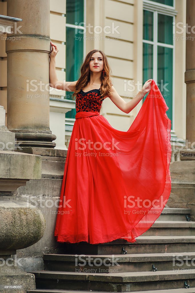 Beautiful young woman in red dress with corset stock photo
