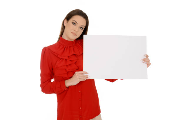 Beautiful young woman in red holding empty pieces of paper – zdjęcie