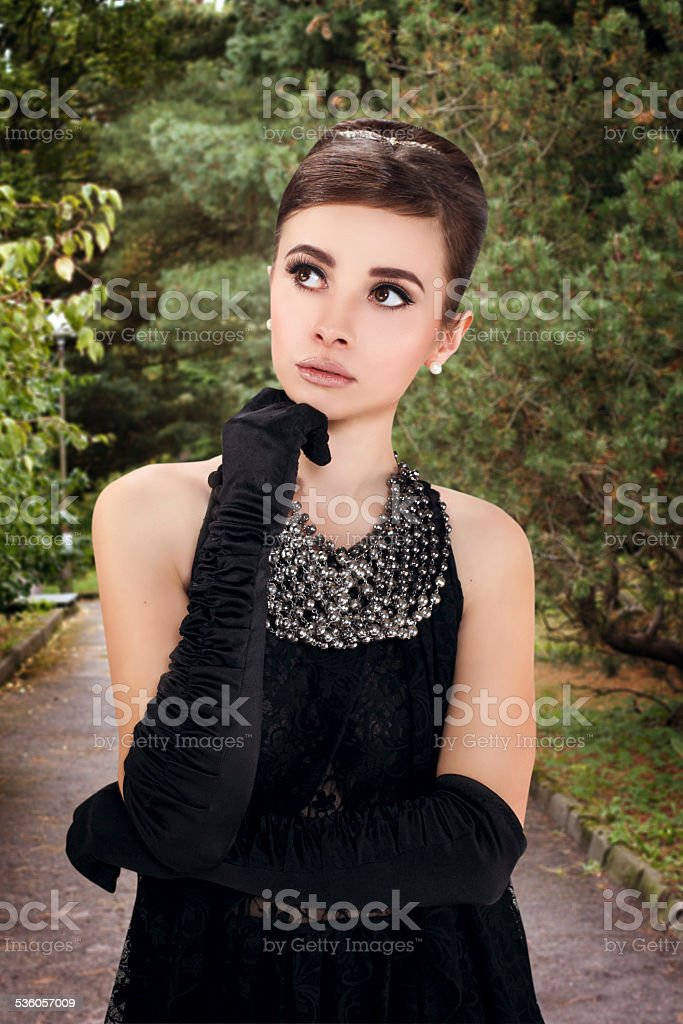 beautiful young woman in retro style on the walk stock photo