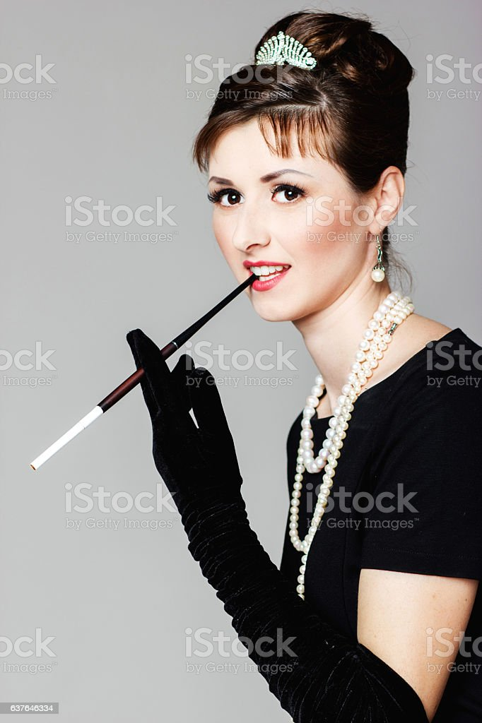 beautiful young woman in retro style with cigarette stok fotoğrafı