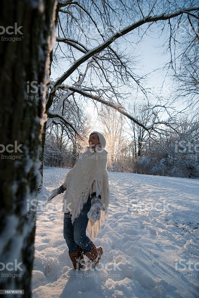 Beautiful young woman in snow royalty-free stock photo
