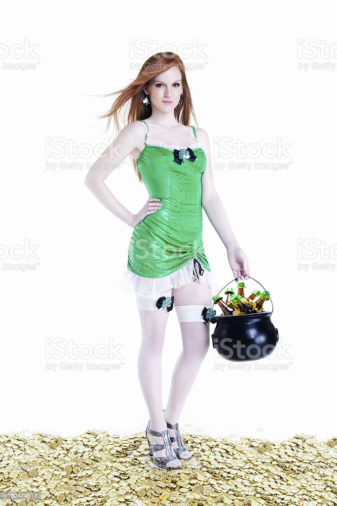 Beautiful Young Woman in St Patricks Costume, Gold, and Beer stock photo