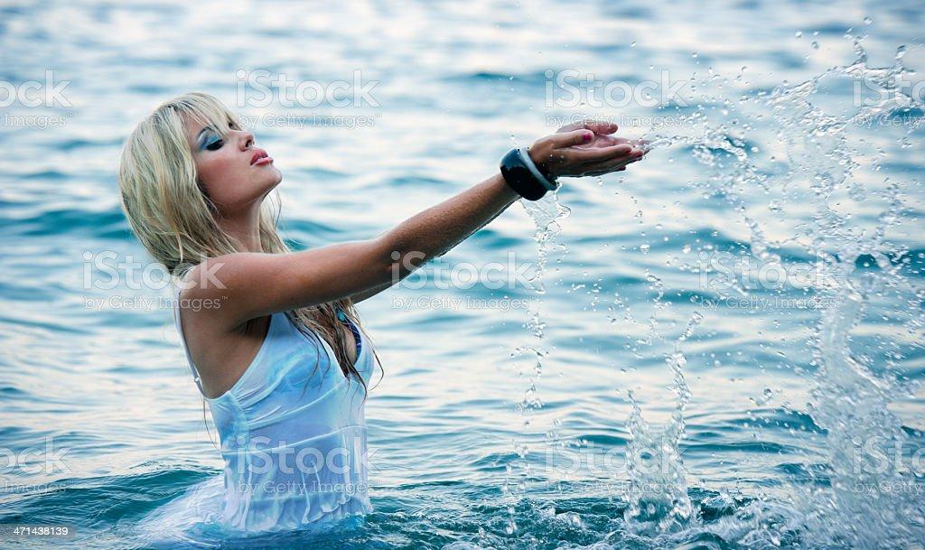 Beautiful young woman in the sea stock photo