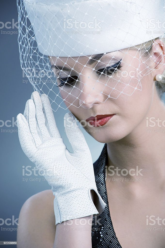 Beautiful young woman in white hat with net veil. royalty-free stock photo