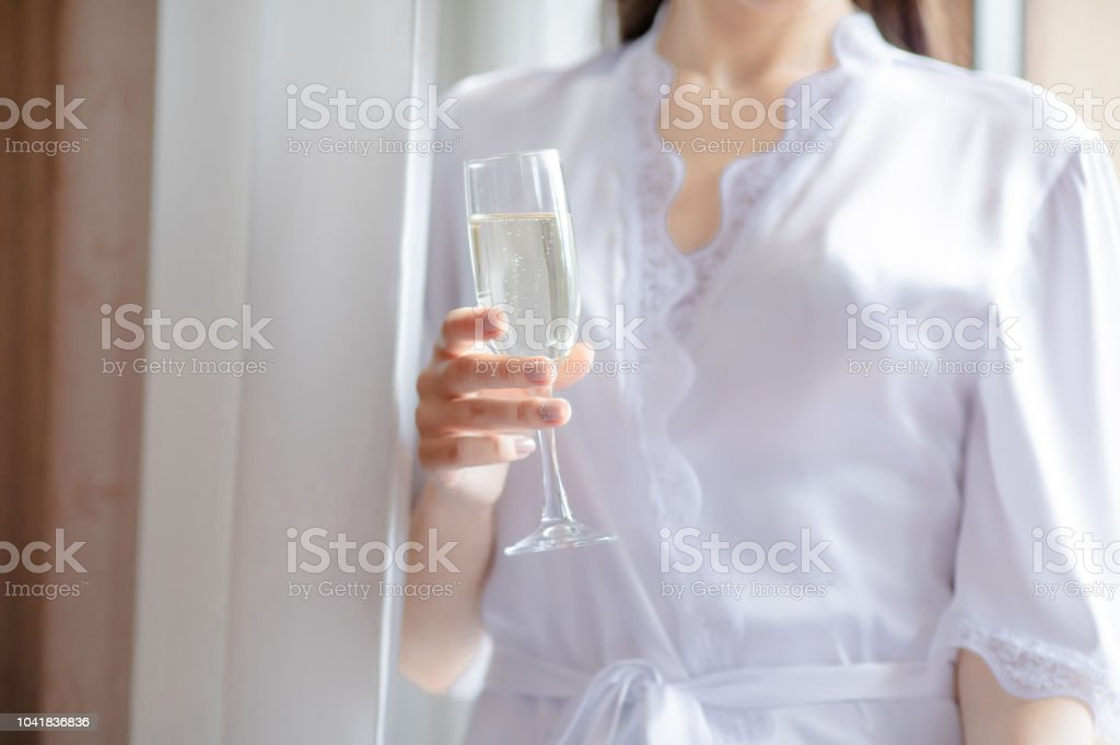 Beautiful Young Woman In White Wedding Robe Holding Champagne Glass In Hand Stock Photo Download Image Now Istock