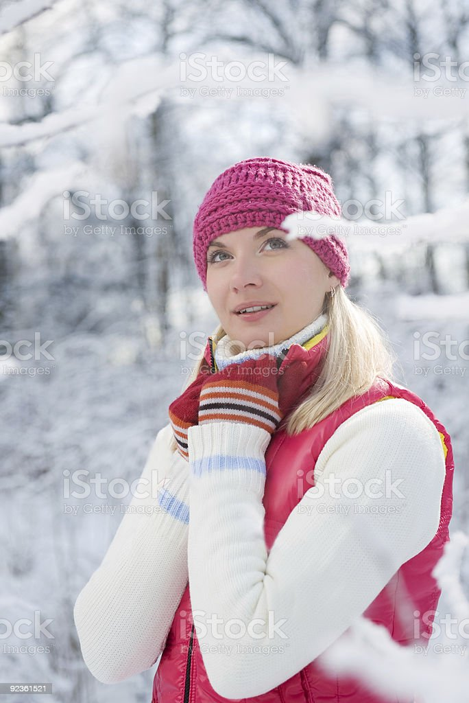 Beautiful young woman in winter forest royalty-free stock photo
