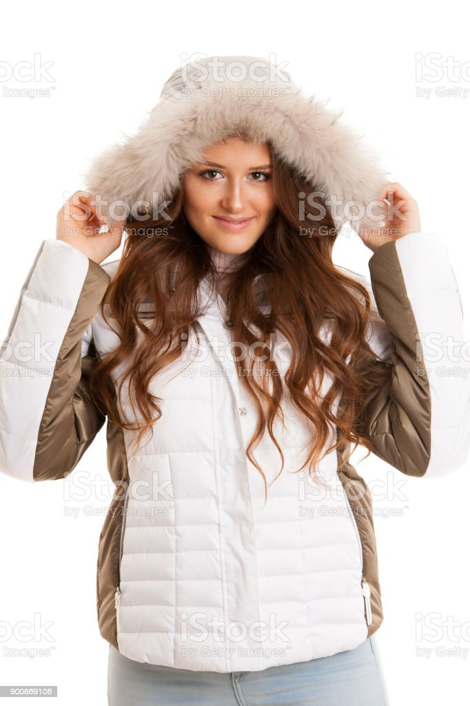 a1ddd7dfcb352 Beautiful young woman in winter jacket isolated over white - Stock image .
