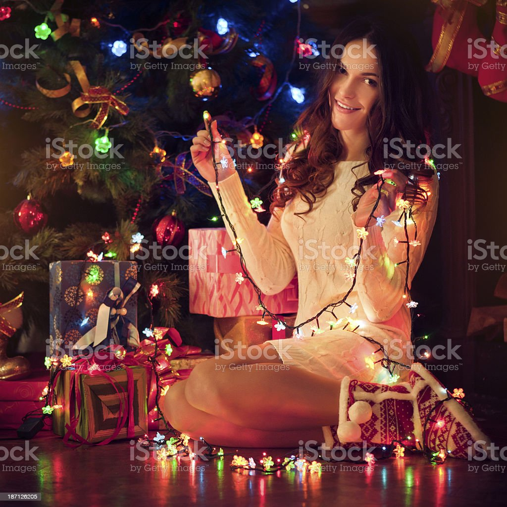 Beautiful young woman in Xmas Eve stock photo