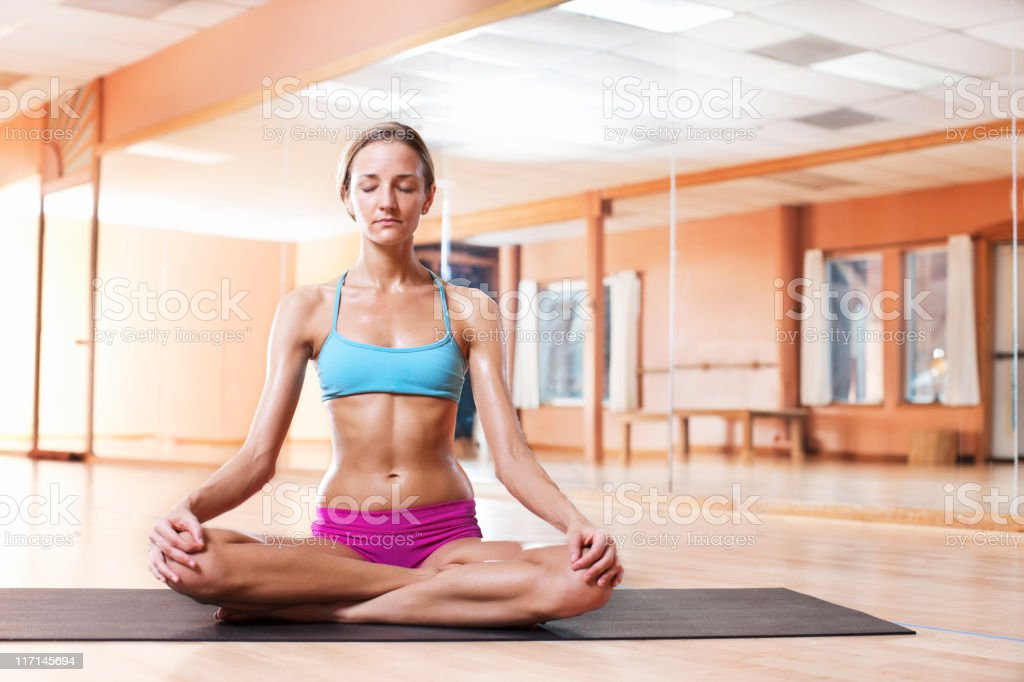 Beautiful Young Woman in Yoga Pose at Studio, Copy Space royalty-free stock photo