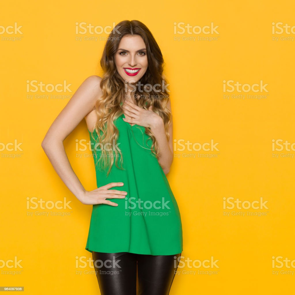 Beautiful Young Woman Is Holding Hand On Chest And Smiling - Royalty-free Adult Stock Photo