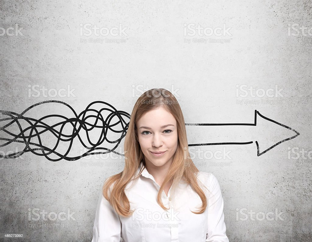 Beautiful young woman is thinking stock photo