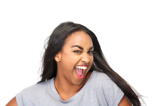 629077968 istock photo Beautiful young woman laughing 181171593