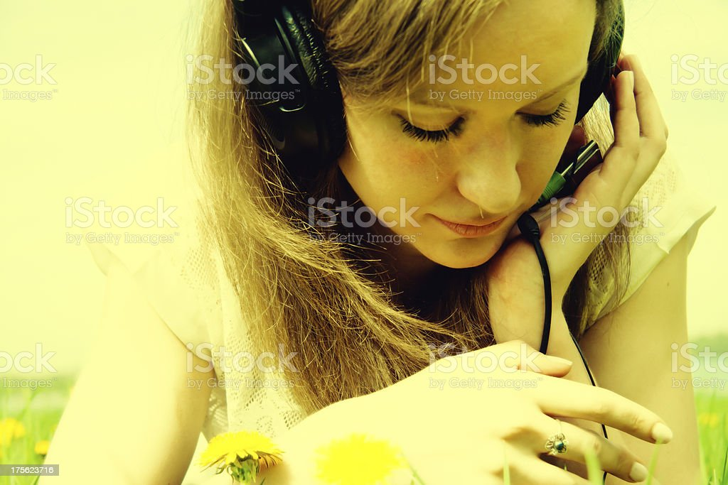 Beautiful young woman listening music royalty-free stock photo