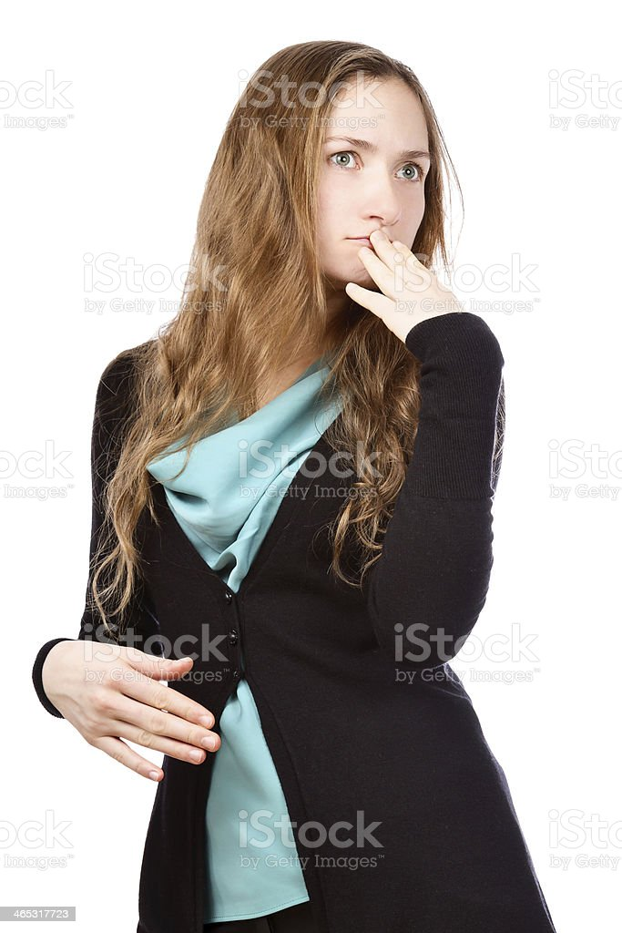 Beautiful young woman looking aside with exaggerated doubting expression royalty-free stock photo