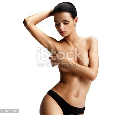 676005390istockphoto Beautiful young woman looking at her clean armpit 675997512