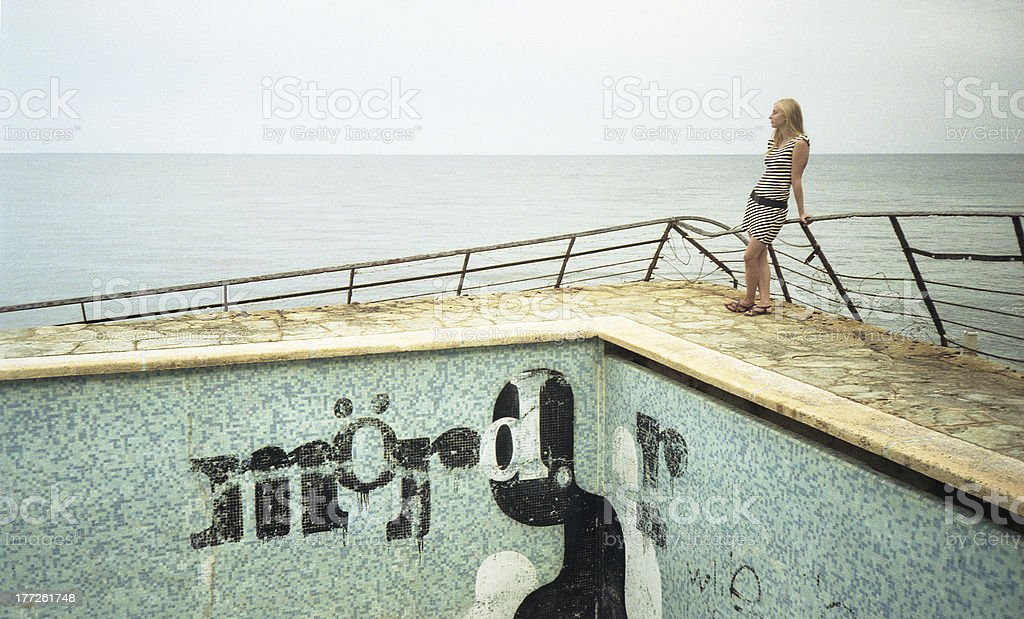Beautiful young woman looking at sea royalty-free stock photo