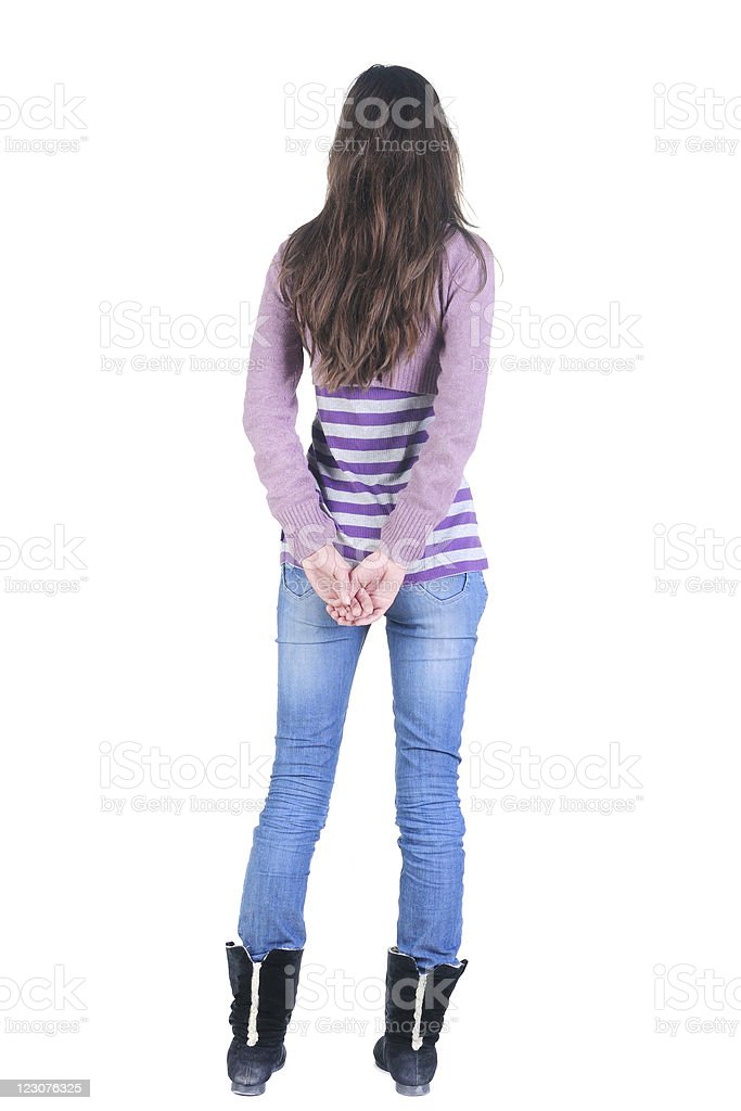 Beautiful young woman looking at wall. Rear view. royalty-free stock photo