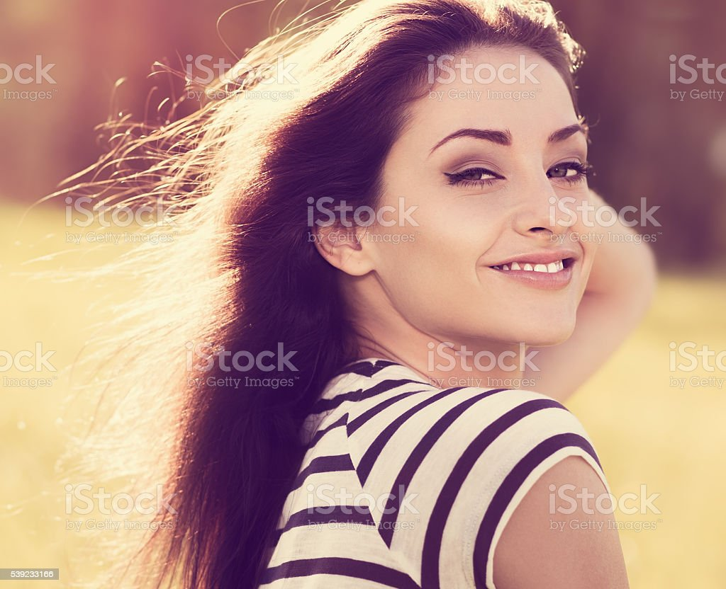 Beautiful young woman looking happy with long hair on nature royalty-free stock photo