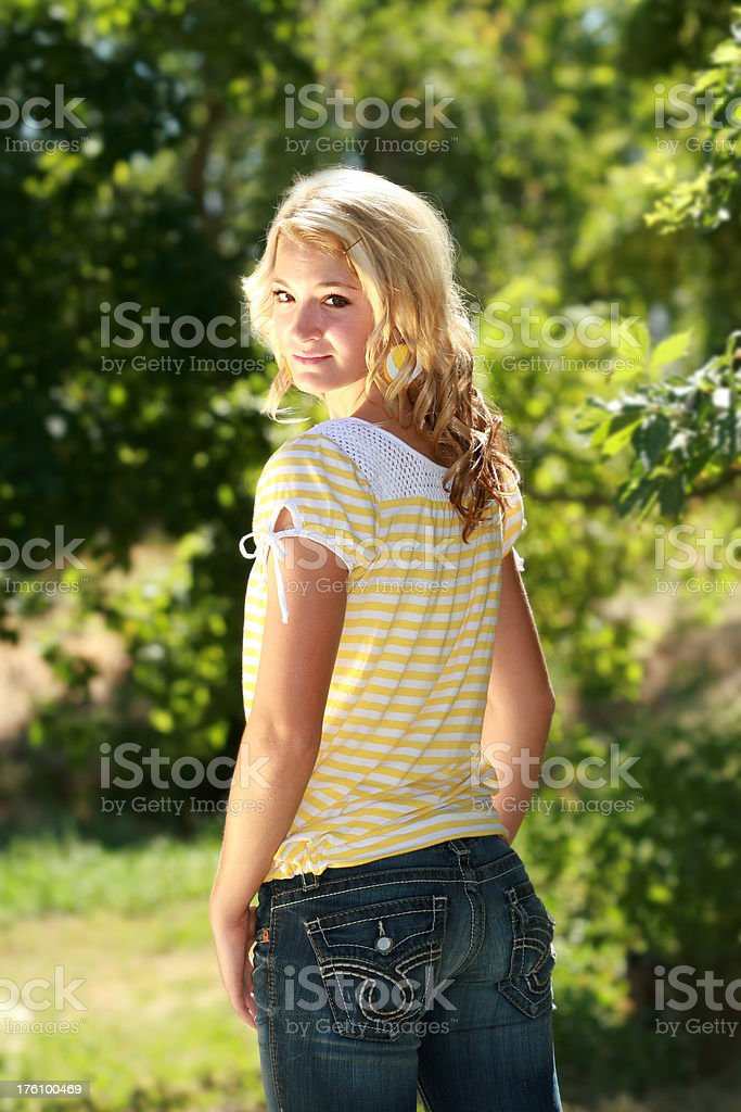 Beautiful Young Woman Looking over her shoulder royalty-free stock photo