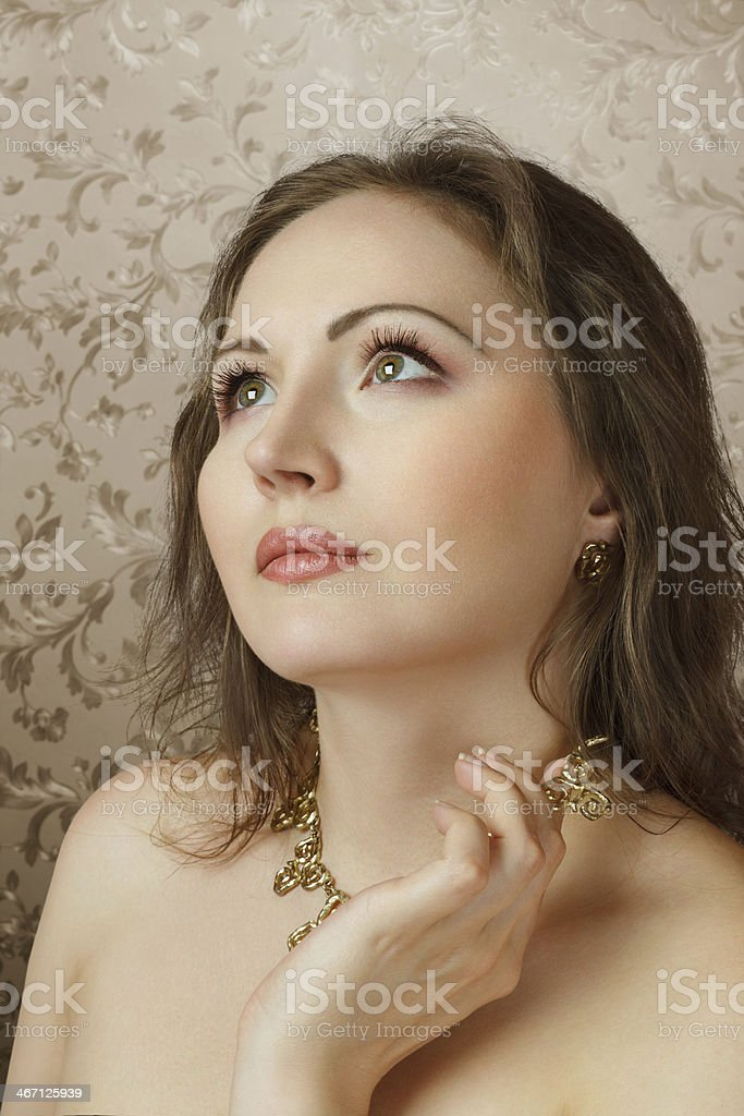 Beautiful young woman looking up royalty-free stock photo