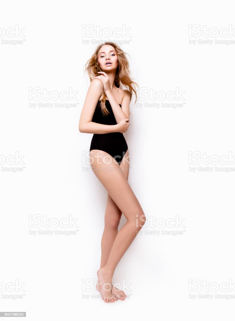 Beautiful young woman looks perfect in bodysuit Full length body portrait stock photo