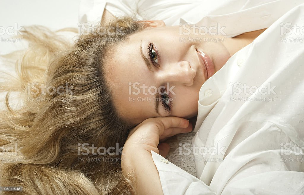 Beautiful young woman lying down royalty-free stock photo