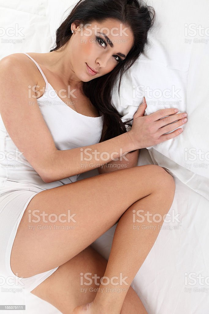 Beautiful young woman lying in bed royalty-free stock photo