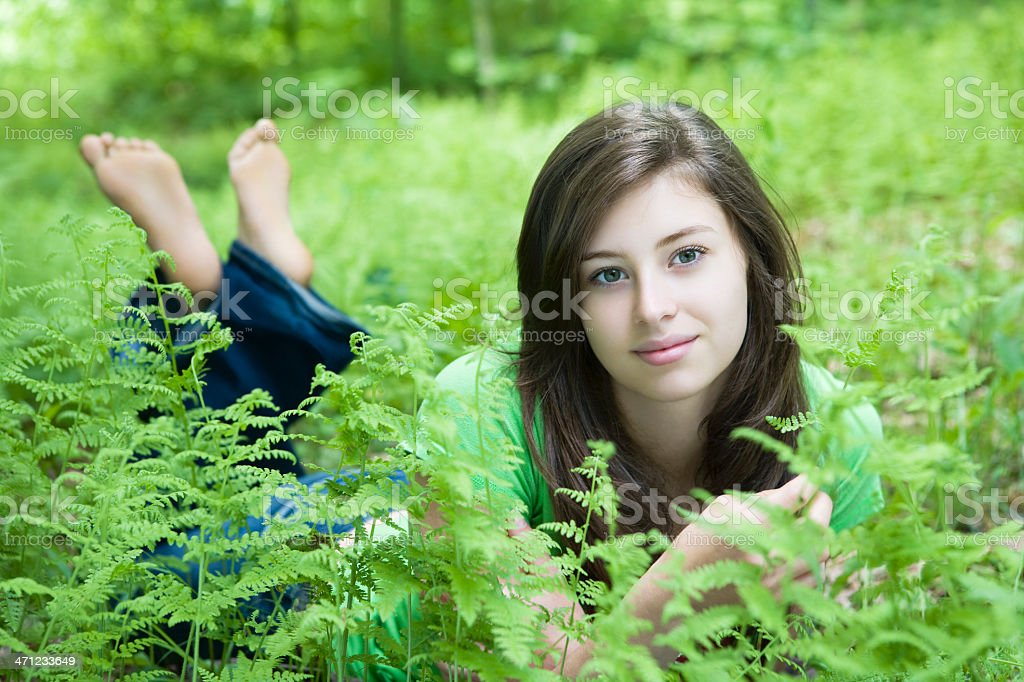 Beautiful Young Woman Lying In The Grass royalty-free stock photo