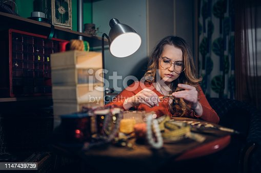 Female jewelry designer making jewelry in the workshop