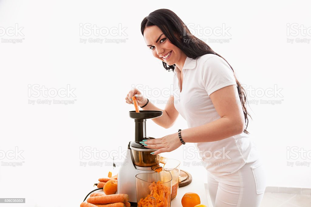 beautiful young woman making juice healthy lifestyle royalty-free stock photo
