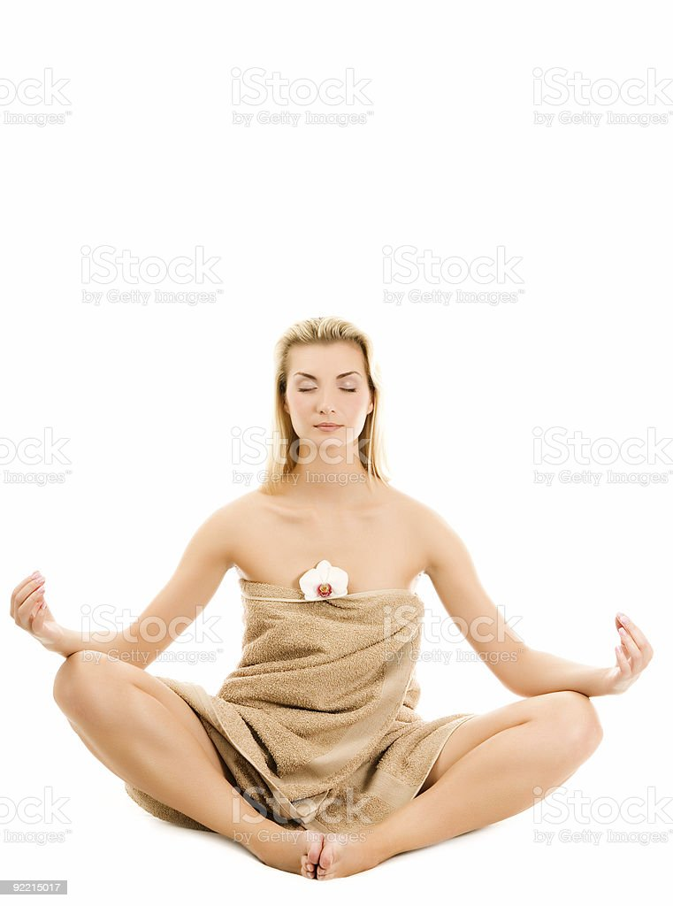 Beautiful young woman meditating isolated on white background royalty-free stock photo