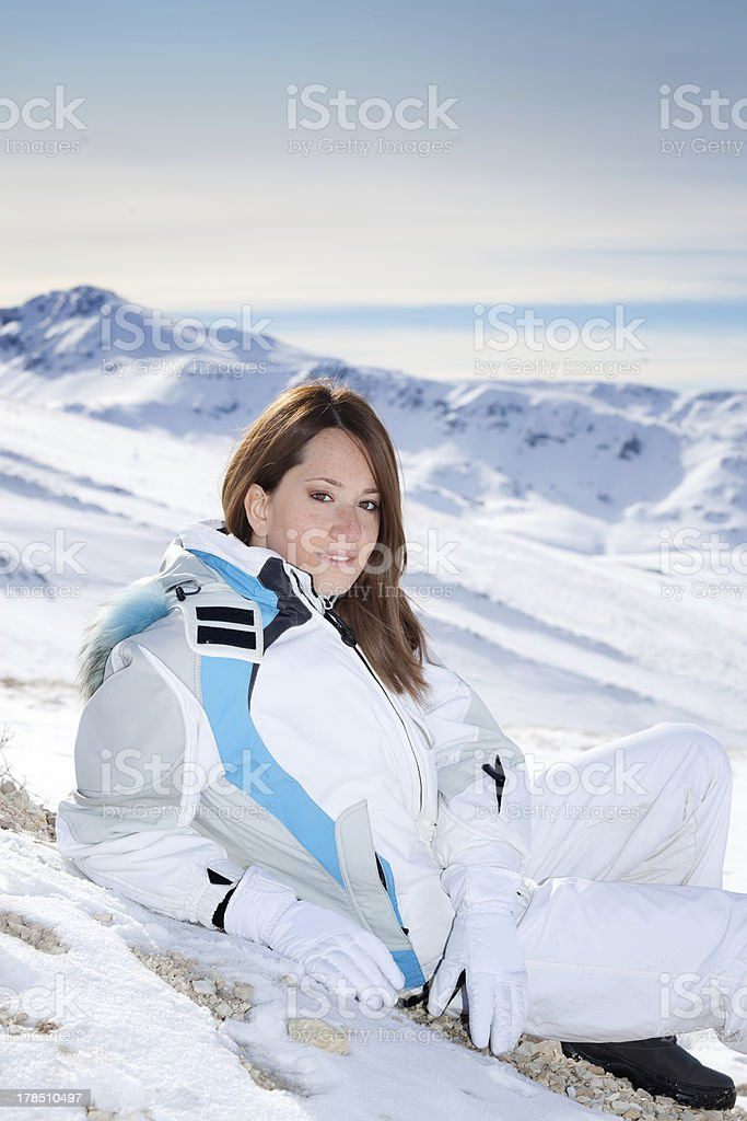 Beautiful young woman on snowy mountain royalty-free stock photo