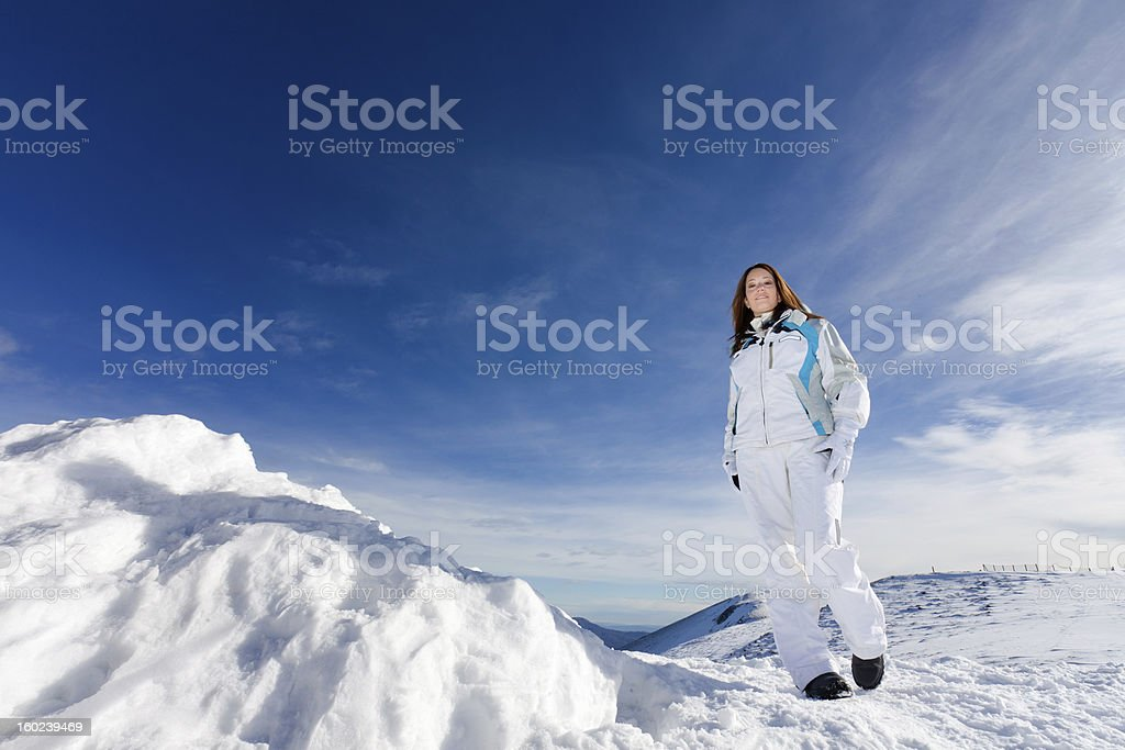Beautiful young woman on snowy mountain -XXXL royalty-free stock photo