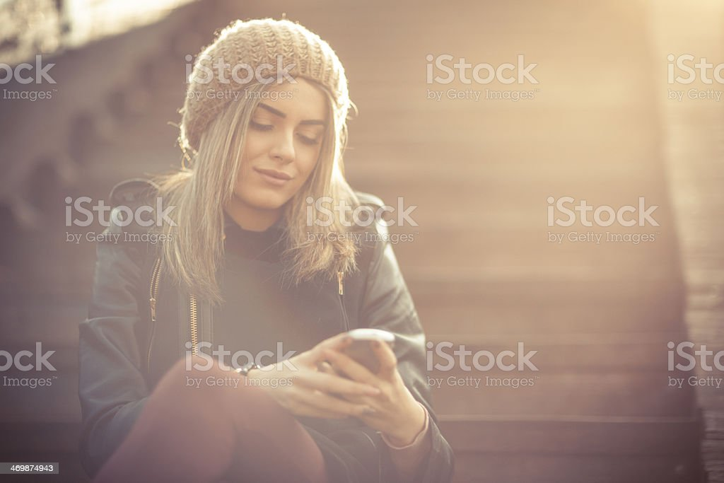 Beautiful young woman on the phone stock photo